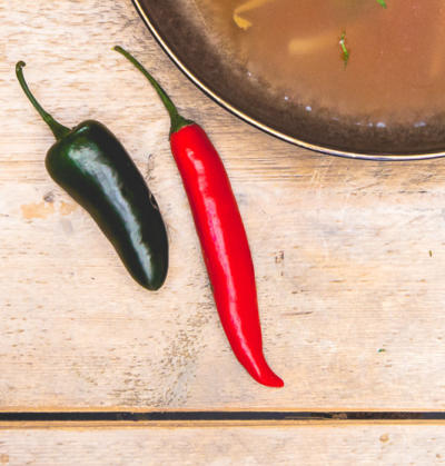 on location food photography with fresh soup and rd and green hot chili pepper