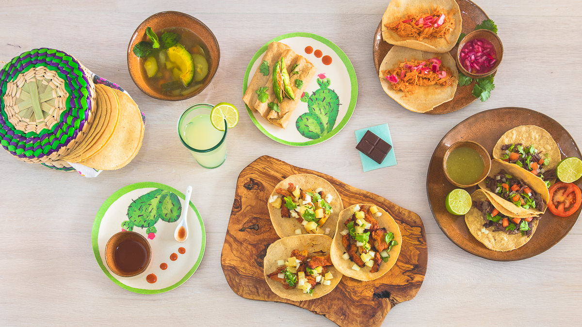 on-location food photography with Mexican dishes with tacos, soup, lime juice, spicy sauce