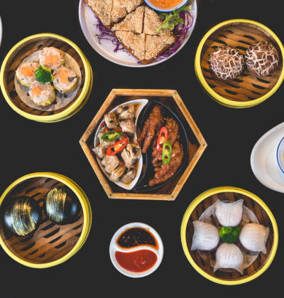 on location food photography with Chinese dishes such as dim sum on a black table