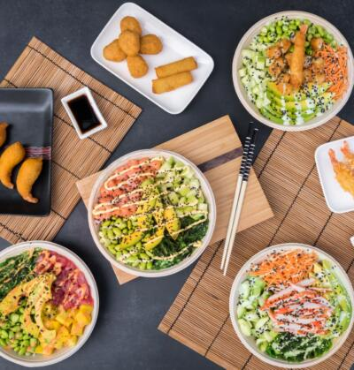 on location food photography with different plates with poke bowls and fried snacks, rolls, springrolls, tempura